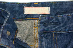 Blue jeans with white cloth label Royalty Free Stock Photo