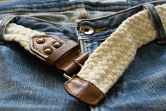 Blue jeans and white woven belt Royalty Free Stock Photography