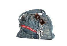 Blue jeans women bag with sun glass isolated Royalty Free Stock Photos