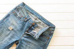 Blue jeans on wood Royalty Free Stock Photos