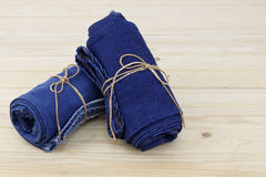Blue jeans on wooden background Royalty Free Stock Image