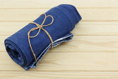 Blue jeans on wooden background Royalty Free Stock Photo