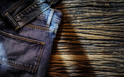 Blue jeans on wooden background Royalty Free Stock Images