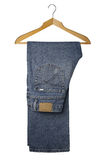 Blue jeans a wooden hanger Stock Images