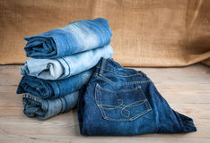 Blue jeans on wooden table Royalty Free Stock Image