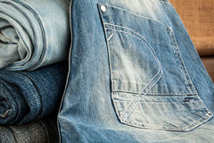 Blue jeans on wooden table Royalty Free Stock Photography