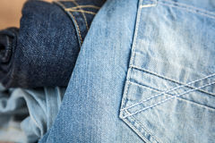 Blue jeans on wooden table Royalty Free Stock Images