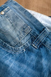 Blue jeans on wooden table Stock Image