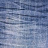 Blue Jeanshintergrund Stockfoto