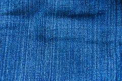 Blue Jeanshintergrund stockfotografie