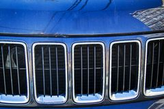 Blue jeep cherokee radiator grill. Closeup of blue jeep cherokee radiator grill Stock Photography
