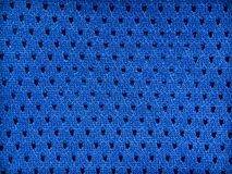 Blue jersey background. Blue mesh sports jersey background Royalty Free Stock Photography