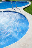 Blue jet spa pool in green grass garden Royalty Free Stock Photo