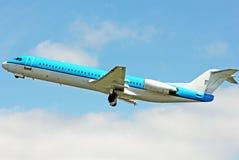 Blue jet taking off Royalty Free Stock Photos