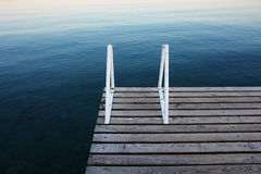 Blue jetty. A jetty on the lake of Garda (Italy royalty free stock photos