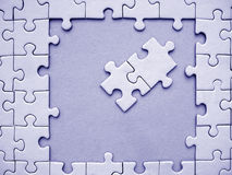 Blue jigsaw elements. Blue jigsaw frame with two jigsaw elements inside stock image