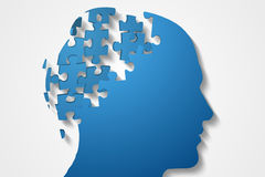 Blue jigsaw head with missing pieces Stock Images