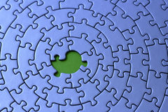 Blue jigsaw with one missing piece. Pieces fitting together in form of a spiral - adobe RGB Royalty Free Stock Images