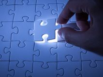 Blue jigsaw puzzle. Business solutions, solving problems,science technology and team building concept stock photography