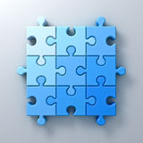 Blue jigsaw puzzle pieces concept on white wall background with shadow