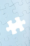 Blue Jigsaw puzzle with white piece missed Stock Photo