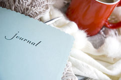 Blue journal book. Put on desk with scarf and cup of coffee Stock Image