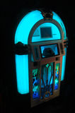 Blue Jukebox. A blue jukebox lit up in the dark Royalty Free Stock Photo