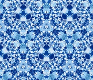 Blue kaleidoscope background. Seamless pattern composed of color abstract elements located on white background. Stock Photography