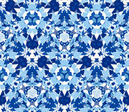 Blue kaleidoscope seamless pattern on white. Blue kaleidoscope seamless pattern. Seamless pattern composed of color abstract elements located on white background Royalty Free Stock Images