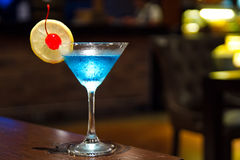 Blue kamikaze. Cocktail on wooden table Royalty Free Stock Photography
