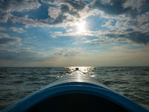 Blue Kayak Floating in the Sea Royalty Free Stock Images