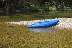 Blue Kayak on Gravel Bar Stock Photos