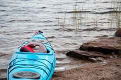 Blue kayak in the lake Royalty Free Stock Photo