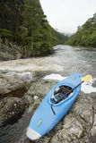 Blue kayak by river Royalty Free Stock Photo