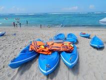 Blue kayaks, paddles  and orange life jackets Stock Images