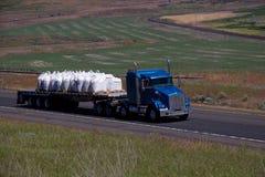 Blue Kenworth / Loaded Flatbed. Oregon, USA royalty free stock photography