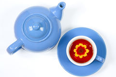 Blue kettle and cup of tea with flowers. The blue kettle and cup of tea with nice flowers Stock Images