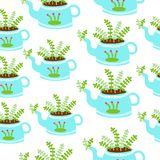 Blue kettles with plants seamless background stock photo