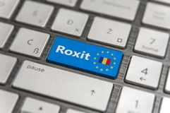 Blue key Enter Romania Roxit with EU keyboard button on modern board. Blue key Enter Romania Roxit with EU keyboard button on modern text communication board Stock Photography