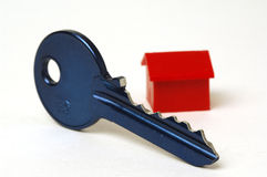 Blue key and house. White background Stock Images
