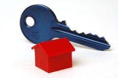 Blue key and house. White background Royalty Free Stock Image