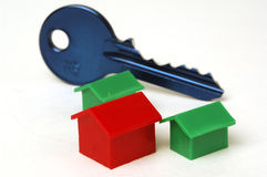 Blue key and house. White background Royalty Free Stock Images