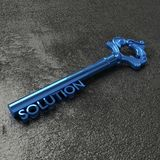 The blue key to solutions on a black stone table Stock Photos