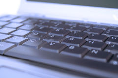 Blue Keyboard. Blue laptop computer keyboard macro Stock Photography