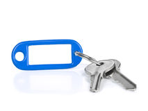 Blue keyring. Two keys on a blank keyring with space for text. Isolated on white Stock Photography