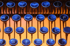 Blue keys on orange. Vintage typewriter keys lit from below with an orange light and on top with a blue light Stock Image
