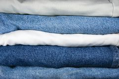 Blue And Khaki Jeans Stack Closeup Stock Photography