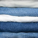 Blue And Khaki Jeans Stack Closeup Stock Photo