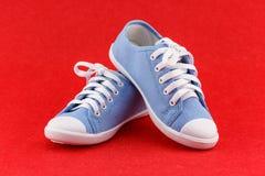 Blue kid shoe Stock Photography