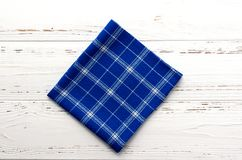 Blue kitchen cloth on white vintage wooden table. copy space.  Stock Photo
